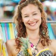 Portrait of a happy woman posing while on the beach — Stockfoto