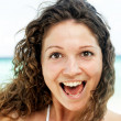 Portrait of a happy young woman posing while on the beach — Foto Stock