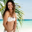 Portrait of a happy young woman posing while on the beach — ストック写真 #20538685