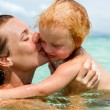 Mother with little daughter on the beach — Stock Photo #21371613