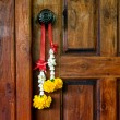 Stock Photo: Traditional Thai bouquet hanging on wooden door