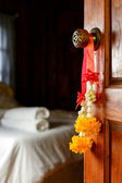 Traditional Thai bouquet hanging on wooden door — Stock Photo