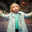 Small funny baby singing outside — Stock Photo #26701067