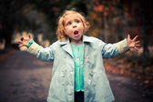 Small funny baby singing outside — Stock Photo