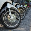 Many motorbikes at the parking — Stock Photo #27169887