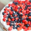 Foto Stock: Tart with strawberries and blueberries