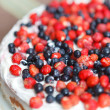 Stock Photo: Tart with strawberries and blueberries