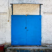 Metal painted blue door — Stock Photo
