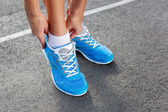 Closeup of Young Woman Tying Sports Shoe — Fotografia Stock