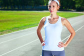 Young woman on stadium preparing herself for marathon run. — Stock Photo