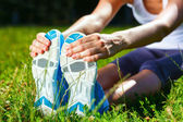 Young woman stretching before exersise - closeup shot. — Stock Photo