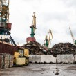 Stock Photo: Recycling, loading scrap metal in the ship
