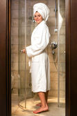Young woman in white bathrobe. — Stock Photo