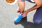 Young Woman Tying Sports Shoes. — Stock Photo