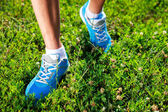 Running shoes on grass. — Stock Photo