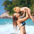 Mother and baby playing on summer beach. — Stock Photo
