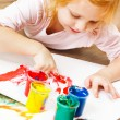 Cute little redhead girl painting. — Stock Photo #33266287