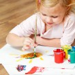 Cute little redhead girl painting. — Stok fotoğraf