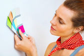 Young beautiful woman holding color palette — Stock Photo