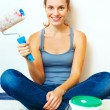 Woman sitting with roller brush ready to work. — Stock Photo #37623299