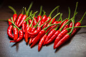 Hot Thai Red Chili Peppers on table — Stockfoto