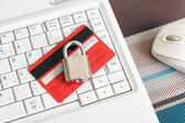 Credit Card and padlock on keyboard. — Stock Photo