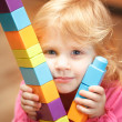 Small Girl playing with construction cubes — Stock Photo