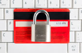 Credit Card and padlock on keyboard - security. — Stock Photo