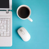 White laptop on table - place for text. — 图库照片