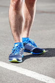 Closeup of a male runner standing. — Stock Photo