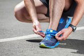 Runner trying running shoes getting ready for run. — Stock Photo