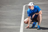 Young male runner getting redy to start. — Stock Photo