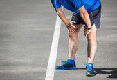 Tired male runner resting after training. — Stock Photo