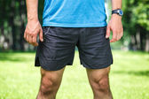 Closeup of a male runner standing - space for text. — Stock Photo