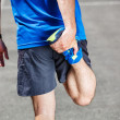 Male runner stretching before workout. — Stock Photo