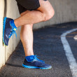 Male runner leaning relaxed against wall. — Stock Photo #47288801