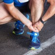 Постер, плакат: Broken twisted ankle running sport injury Male runner touchin