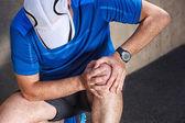Male runner having problems in knee joint. — Stock Photo