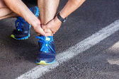 Broken twisted ankle - running sport injury. Male runner touchin — Stock Photo