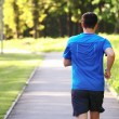 Young man running outdoors in the morning. — Stock Photo #48081239