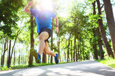 Young man running outdoors in the morning. — Stock Photo