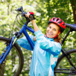 Portrait of young woman with mountain bike on shoulder. — Stock Photo #48925645