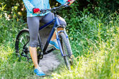 Young woman with mountain bike outdoors. — Stock Photo