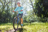 Young woman on mountain bike fast ride outdoors. — Stock Photo
