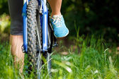 Closeup of woman riding mountain bike outdoors. — Photo