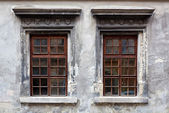 Two windows on an old gray stucco wall. — Stock Photo