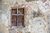 Closed blocked window and old stone wall background — Stock Photo