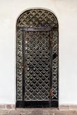 Old black metal door. — Stock Photo