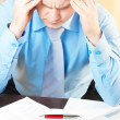 Portrait of a young businessman with headache — Stock Photo #5741603