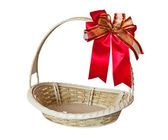Basket with red ribbon — Stock Photo